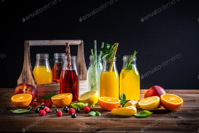 Assortment of juices and lemonades with fruits and herbs