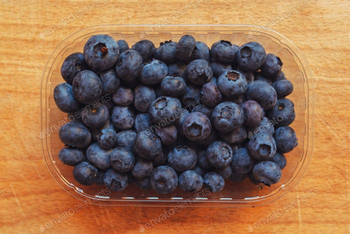 Blueberries myrtilles in plastic container box