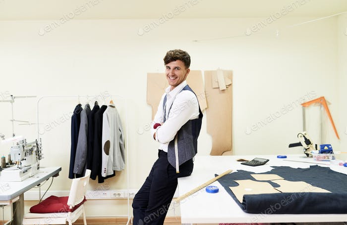 Handsome Young Tailor in Atelier
