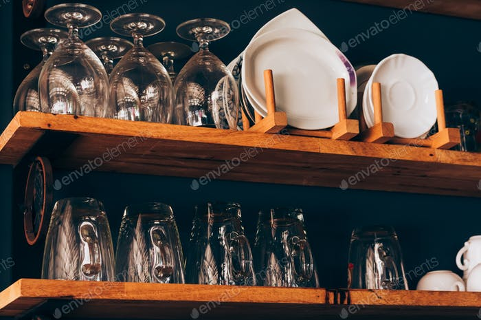 Drinking glass on the wooden shelf