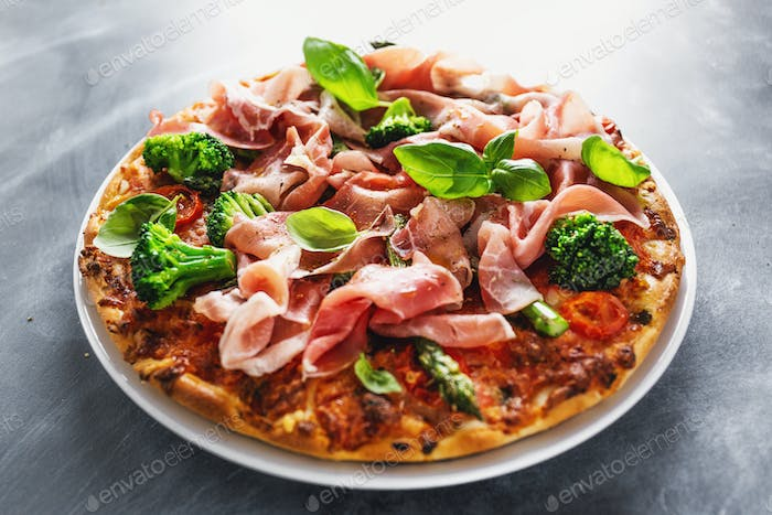 Italian classic pizza with meat and broccoli