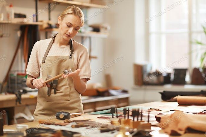 Female Artisan With Hammer