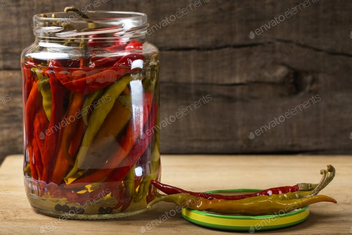 Marinated hot peppers in jar