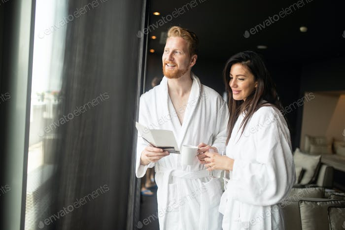 Happy young couple enjoying wellness spa resort treatments