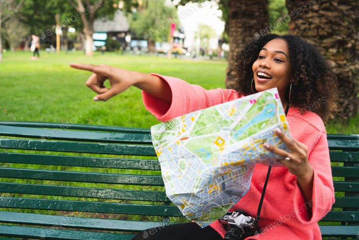 Afro-american woman with map. Travel concept.