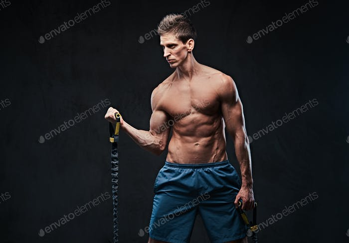 A man warms up with the latex resistance band.