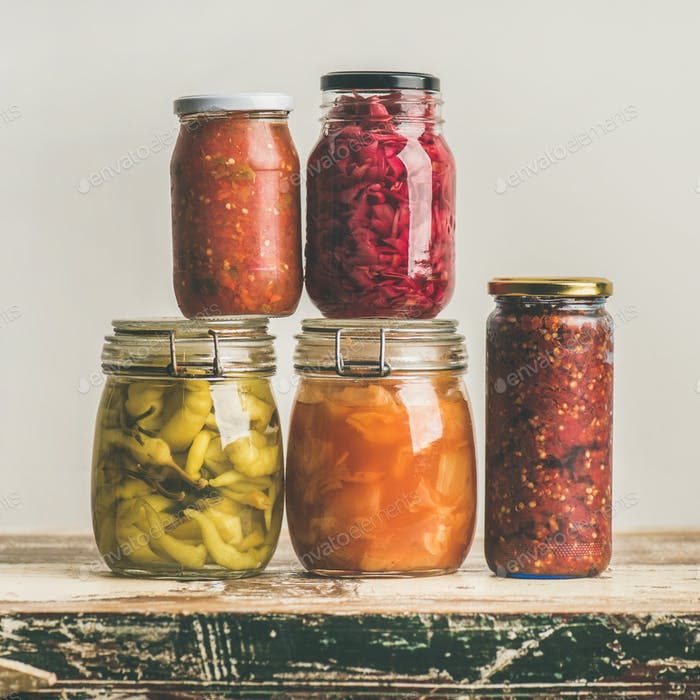 Autumn seasonal pickled or fermented vegetables in jars, square crop