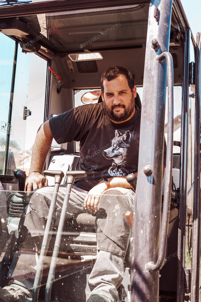 Portrait of a man driving machinery