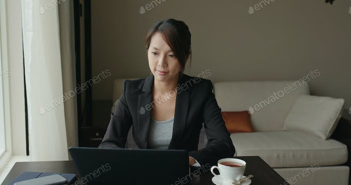 Businesswoman work on laptop computer at hotel room