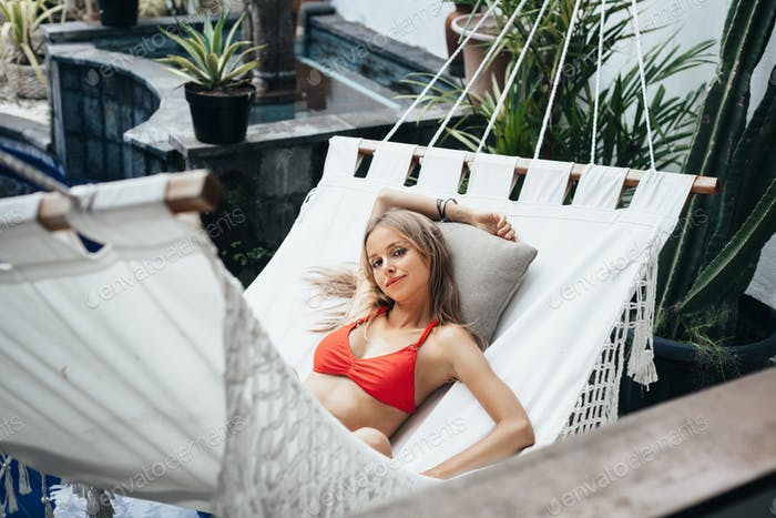 Thumbnail for Woman laying down on white hammock