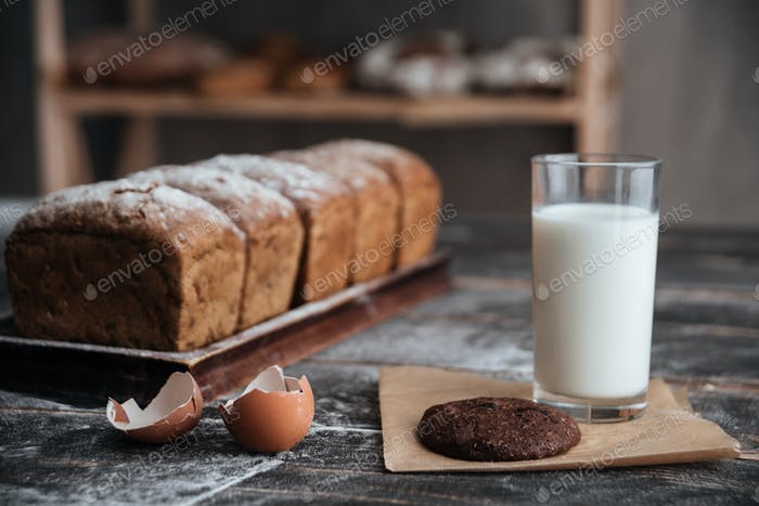 Bread with milk and cookie near eggs