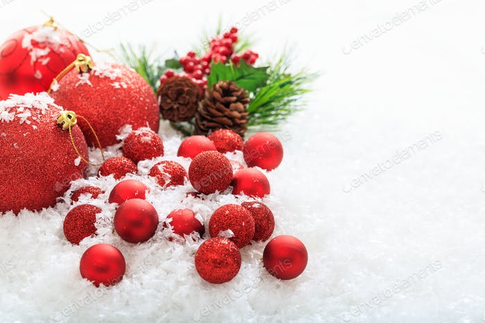 Christmas balls and snow on white background