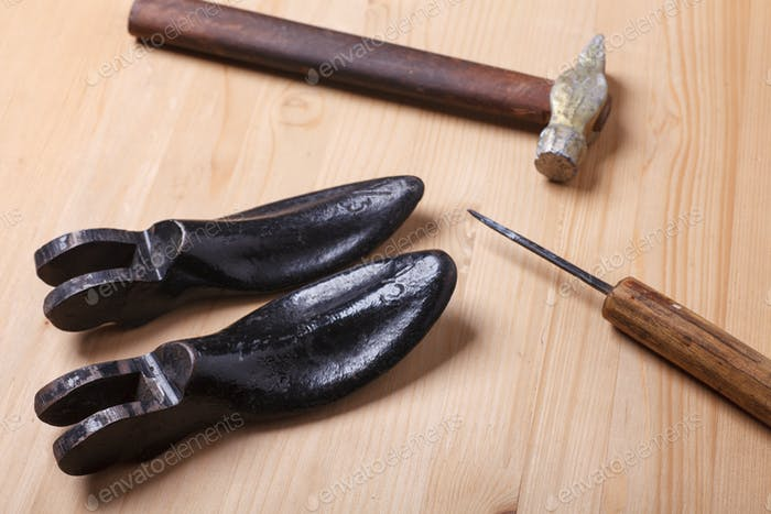 shoemaker's instruments on wooden table