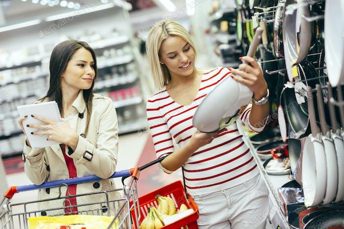 Women shopping cookware