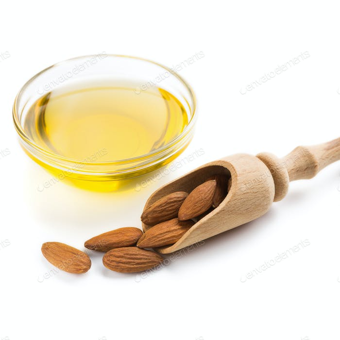 Almond oil in bowl on white