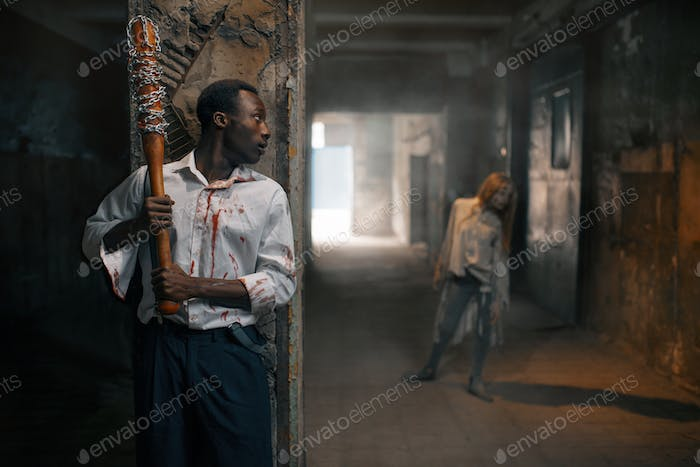 Man with baseball bat prepares to kill zombie