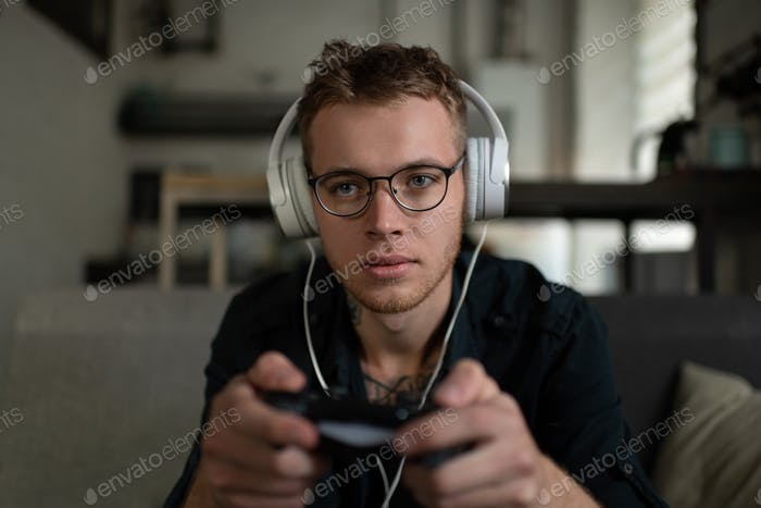 Serious guy playing video game