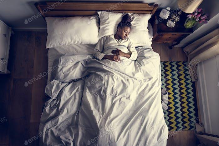 African American woman on bed sleeping