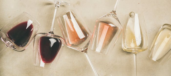 Red, rose and white wine in glasses, wide composition