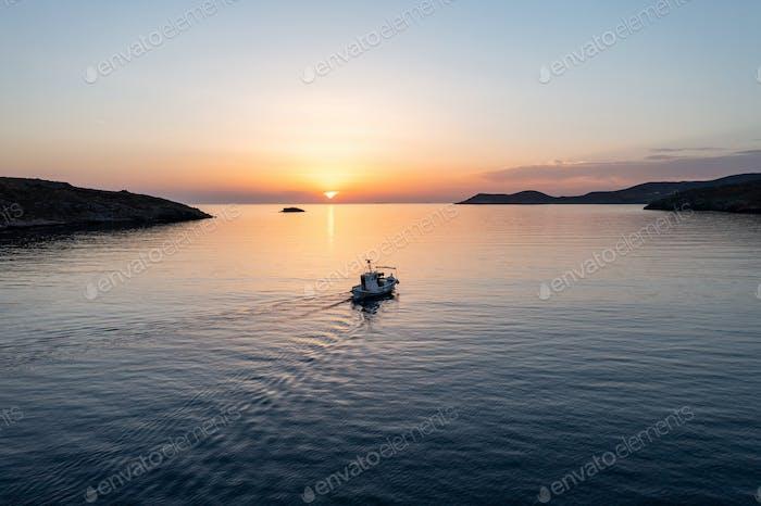 Fishing boat at sunset.