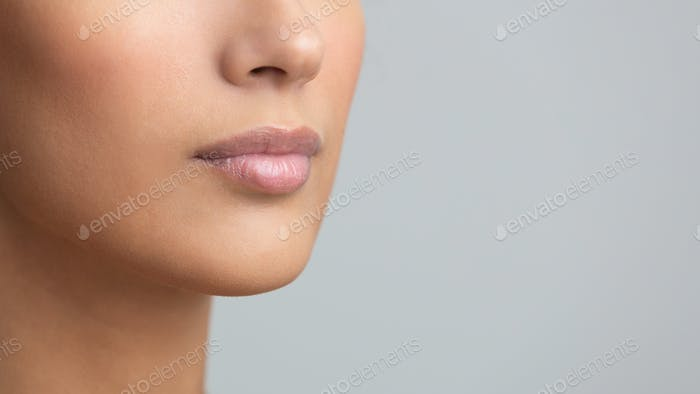 Perfect natural lip makeup, grey studio background