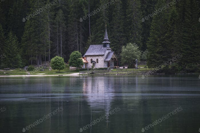 Gothic Church at lake Braies in the Dolomites