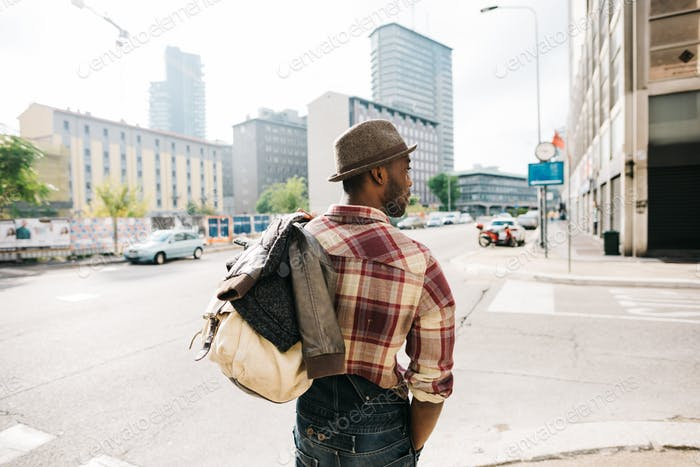 Thumbnail for Half length of young handsome afro black man walking in the stre