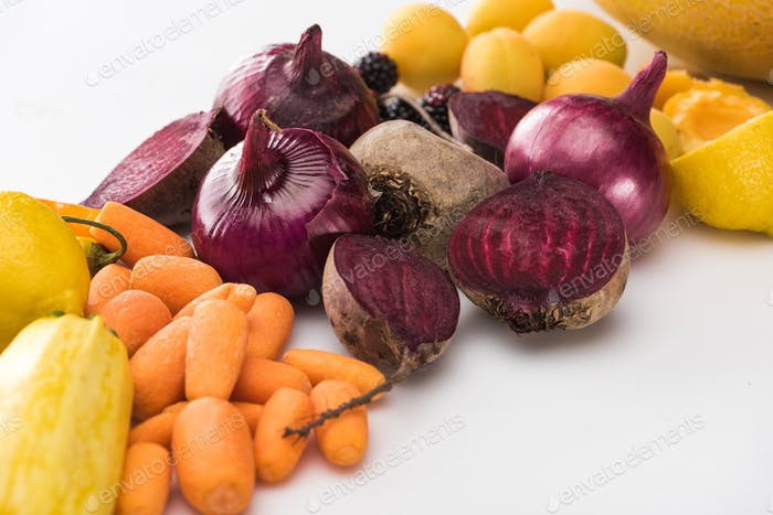 Carrots, Red Onions, Beetroots, Apricots on White Background