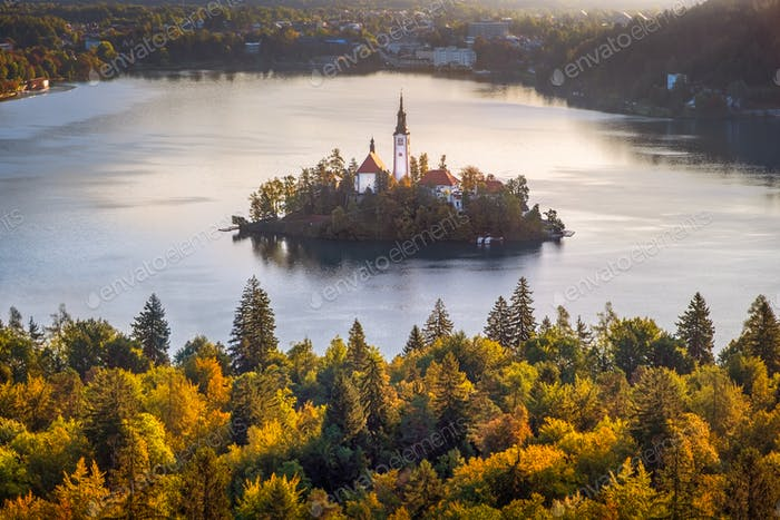 Colorful landscape view of and island and Lake Bled with colorful autumn foliage, Slovenia