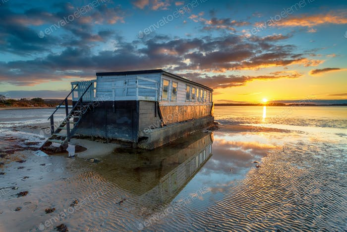 Stunning sunset over an old houseboat moored at Bramble Bush Bay