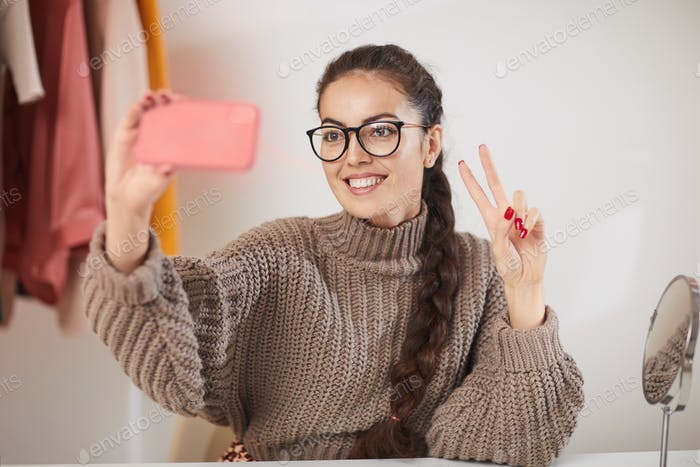 Young Woman Taking Selfie at Home