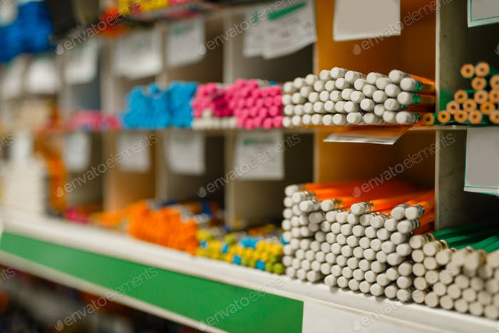 Shelf with pencils in stationery store, nobody