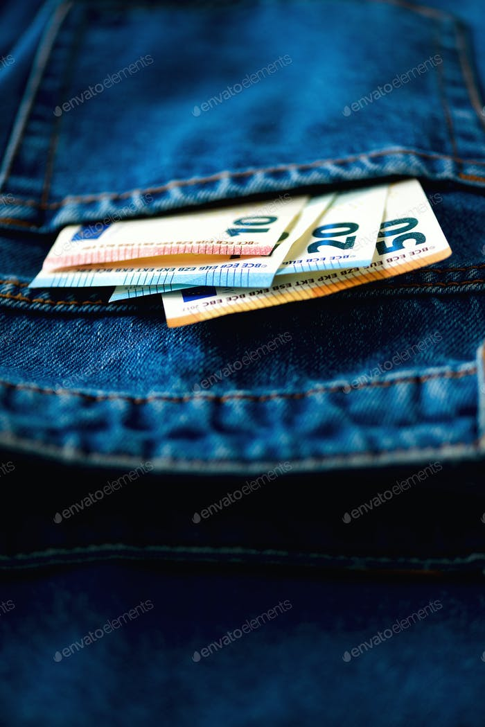 Euro banknotes in jeans pocket. Success, wealth and poverty, poorness concept. Euro currency