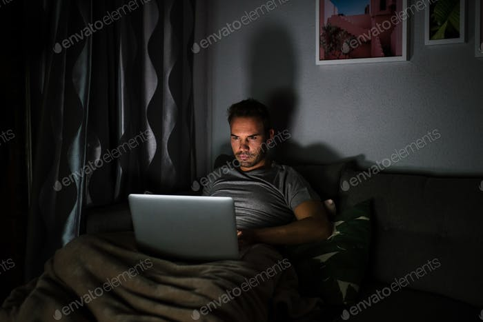 Man in pajamas with a computer
