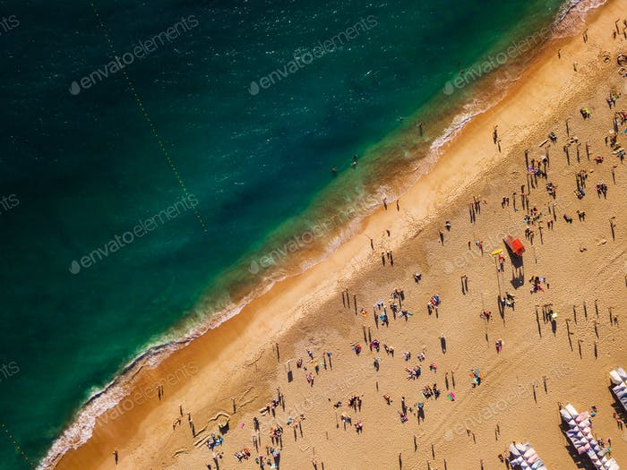 View from above to a busy beach. Coast of the Atlantic Ocean