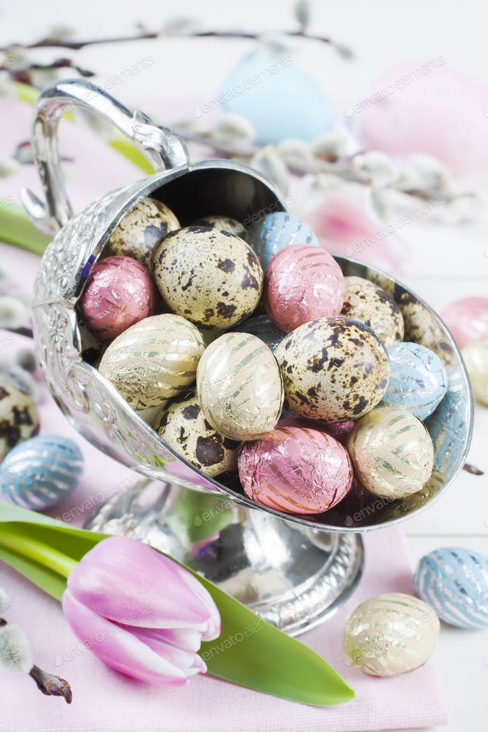 Colorful chocolate easter eggs in metal vase