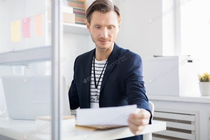 Adult Office Worker Reading Document