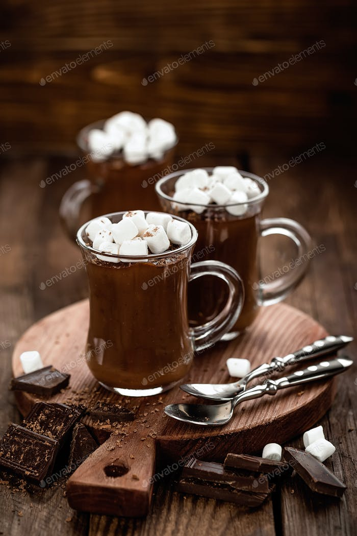hot chocolate dessert with marshmallows on wooden background