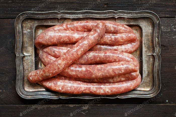Raw Sausages on a metal tray