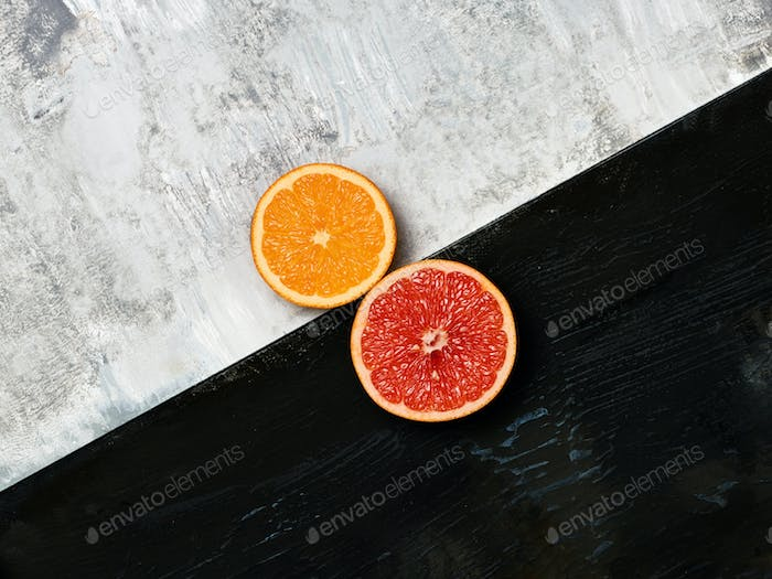 Grapefruit citrus fruit halves on wooden