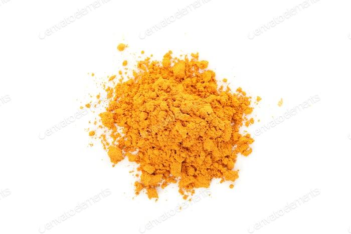 Fragrant turmeric powder heap isolated on white background