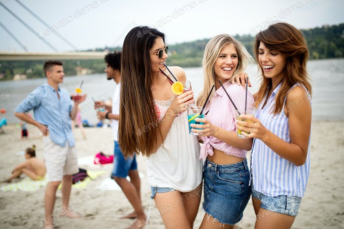 Group of young friends enjoying outdoor summer party