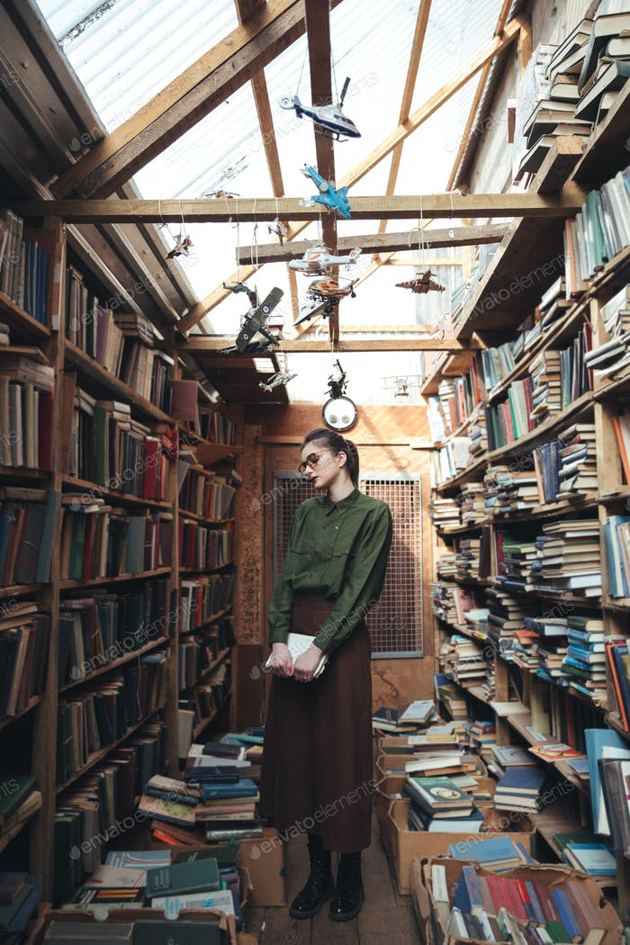 Full-length shot of woman in library