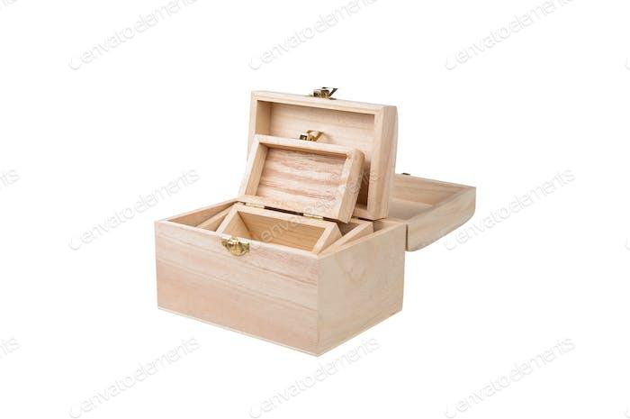 drei Schachteln Tanne mit goldener Schließe