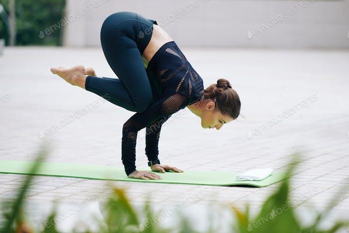 Woman doing crow pose