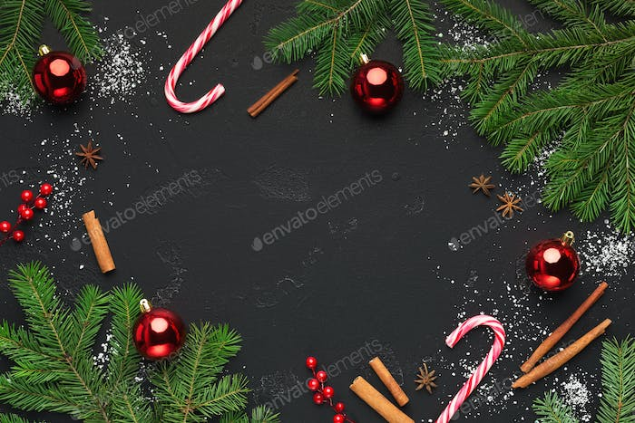 Christmas background with christmas tree branches and candies