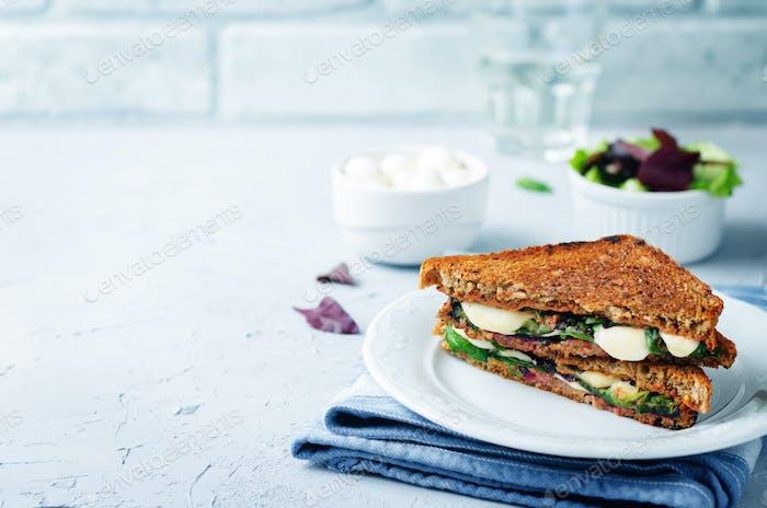 Fresh green mozzarella grilled rye sandwich