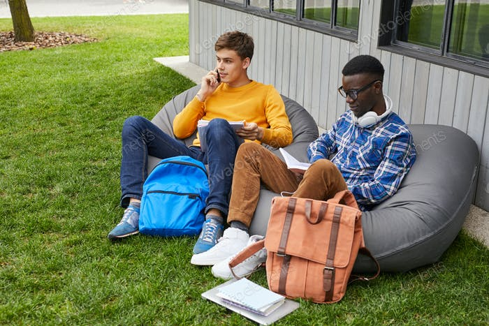 Students Relaxing Outdoors