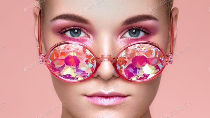 Portrait of beautiful young woman with colored glasses