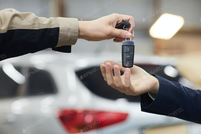 Giving Car Keys To Owner